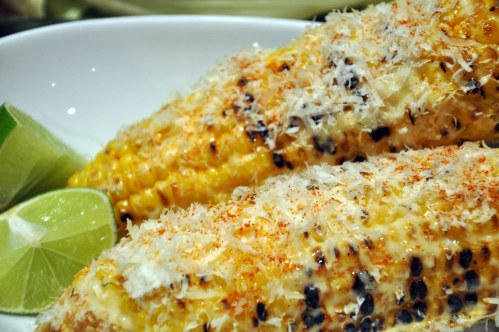 Grilled corn with mayonnaise, chili powder, cotija cheese and a dash of lime
